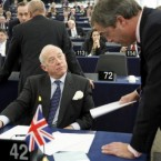 British member of the European Parliament Godfrey Bloom talks with UKIP party chief Nigel Farage, at the European Parliament in Strasbourg. Bloom was expelled from the European Parliament chamber Wednesday for calling German Socialist MEP Martin Schulz an
