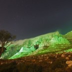 Table mountain is seen lit up in green, in a spectacular display to commemorate St Patrick's Day in Cape Town, South Africa.
