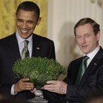 President Barack Obama receives a bowl of shamrock from Prime Minister Enda Kenny of Ireland at a St Patrick's Day celebration in the East Room of the White House in Washington. 