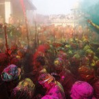 This photograph is almost like a vivid painting - it depicts Indian villagers who smeared themselves with colours to celebrate Holi festival in Nandgaon, near Mathura. (AP Photo/Pankaj Nangia)