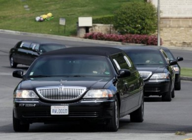Mourners' cars leaving the LA cemetery where Liz Taylor was laid to rest yesterday