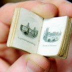 A miniature 19th century Bijou picture book of London, one of a number of tiny books up for auction in England. Pic: Rui Vieira/PA Images.
