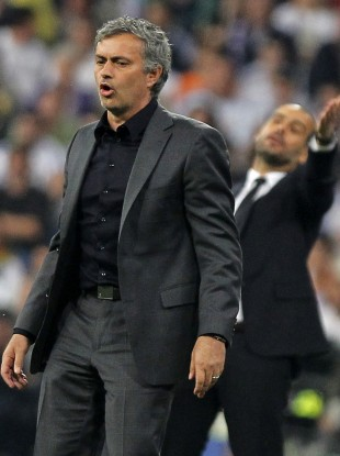 Jose Mourinho on the sideline with Pep Guardiola, before his sending off.