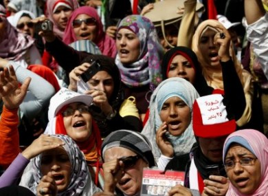 Egyptian women chant slogans as they attend a demonstration in Tahrir Square in Cairo, Egypt, Friday, April 1, 2011.