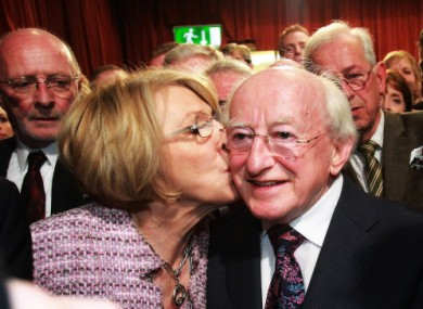 Michael D Higgins gets a kiss from wife Sabina Coyne as it becomes clear that he's in line to become President of Ireland - and for a €250,000 pay packet.