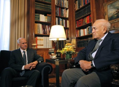 Greece's prime Minister George Papandreou, left speaks to Greek President Karolos Papoulias, today