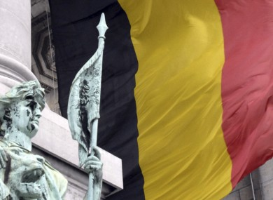 A tattered Belgian flag blowing in the wind at the Cinquantenaire monument in Brussels (File)
