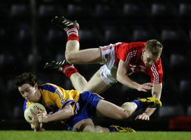 Cork's Ruairi Deane and Stephen Collins of Clare at Pairc Ui Rinn.