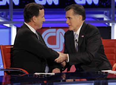 Rick Santorum (left) and Mitt Romney didn't quite appear arm-in-arm - but Santorum has nonetheless given Romney his backing in November's presidential election.