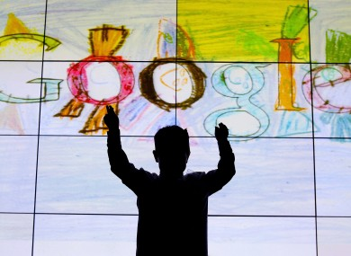 Darragh Brady from Edmondstown National School in Dublin in front of his doodle on stage at Google offices in Dublin after he won the Junior category in the 'Doodle for Google' competition in March