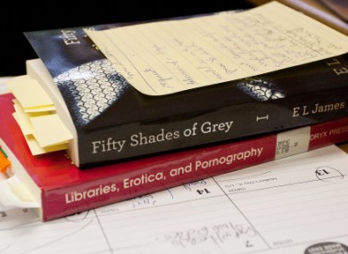 One US librarian, whose desk is pictured here, recommended that her library system did not stock the book as she deemed it primarily erotica.