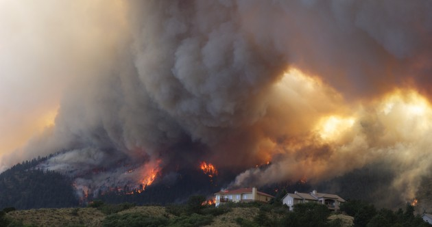 Dramatic photos of canyon wildfires as Colorado residents flee flames