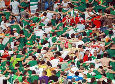 Republic of Ireland supporters do 'The Poznan' during the Italy game.
