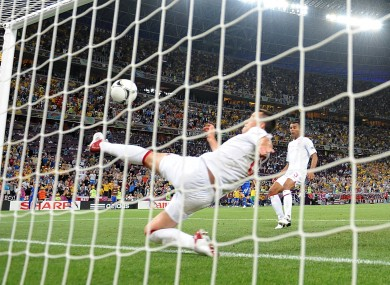 England's John Terry attempts to clear the ball off the line. No goal is awarded.