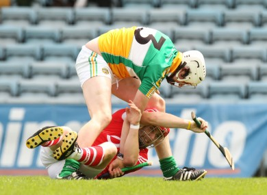 Offaly's David Kenny challenges Cork's Paudie O'Sullivan in last year's clash.