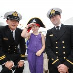 Lt Smith (left) and Ens Carroll with Demi Mooney, 10, from Dublin. (Sasko Lazarov/Photocall Ireland)