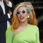 Big hair, big glasses, bright dress and bulging bank account - that's our Lady Gaga, who was paid  million last year.