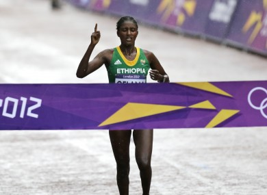 Ethiopia's Tiki Gelana crosses the line to win the gold in the women's marathon at the 2012 Summer Olympics.