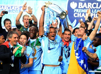 Manchester City captain Vincent Kompany lifts the Premier League trophy.