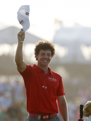 Rory McIlroy waves to his father after he sealed the win last night.