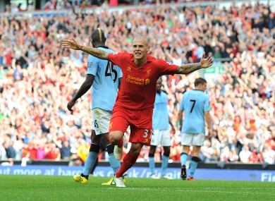 Liverpool's Martin Skrtel celebrates after scoring his team's opening goal on Sunday.