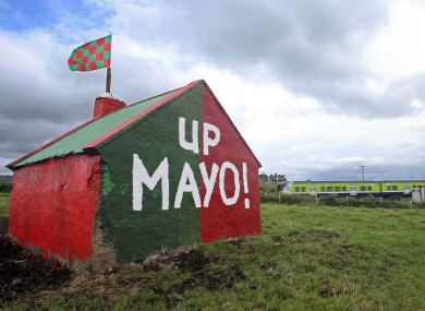 A view of a painted shed in a field on the road to Claremorris.