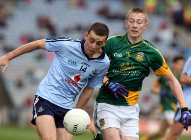 Cormac Costello of Dublin with Brian Power of Meath during their All-Ireland Minor Football Final clash.