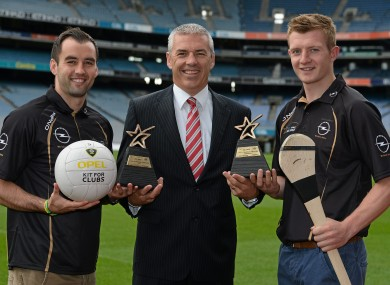 Donegal footballer Karl Lacey and Galway hurler Joe Canning with Opel's Ray Finlay.