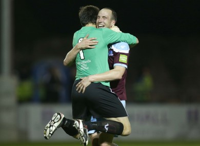 Drogheda United's Gabriel Sava hugs Alan Byrne after teammate John Sullivan's late winning goal.