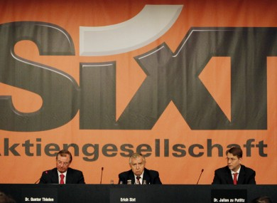 Erich Sixt, center, CEO of the German car rental company Sixt AG waits for the start of the annual shareholders meeting in Munich
