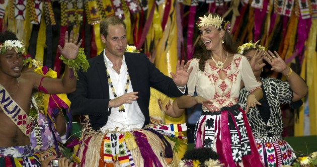 In pictures: The Royal pair on holidays with costumes, canoes and cake