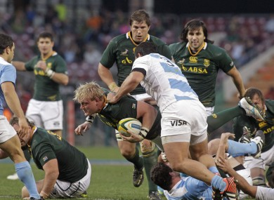 Adriaan Strauss, center, runs into Juan Figallo.