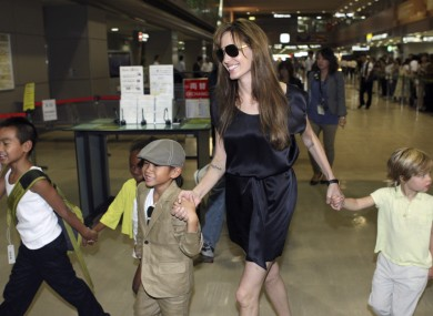 Angelina Jolie and moody Shiloh, right