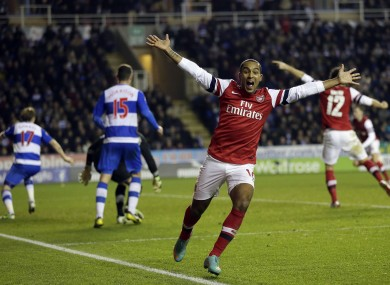 Theo Walcott celebrates as Arsenal stage a remarkable comeback.