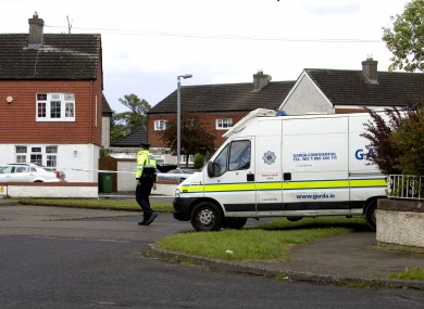 Gardai at the scene in Moorfield Avenue at the time of the killing.
