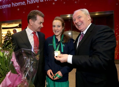 Professor Ciaran O'Cathain of Athletics Ireland, Fionnuala Britton with her medals and Minister of State for Sport Michael Ring.