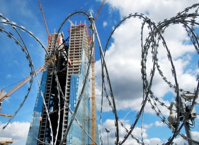The site of the ECB's future new headquarters in Frankfurt, seen guarded by barbed wire.