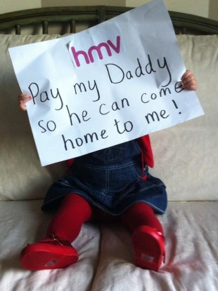 Kitty Mullane holds up a sign in support of her dad who is the assistant manager of the HMV store in Crescent Shopping Centre, Limerick.