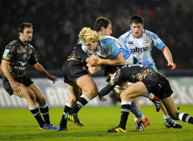 Richie Gray is tackled by Montpellier's Santiago Fernandez (left) and Francois Trinh-Duc (right).