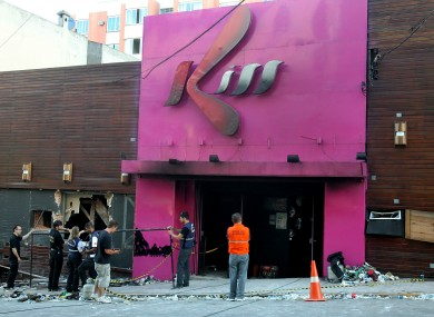 Police investigators inspect the entrance of the Kiss nightclub in Santa Maria city in January.