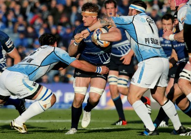 Glasgow's Josh Strauss and Ryan Grant tackle Jamie Heaslip of Leinster.