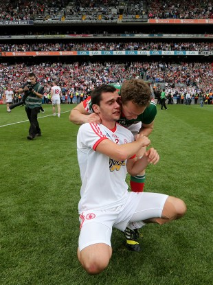 Mayo's Andy Moran consoles Ryan McKenna of Tyrone after the game.