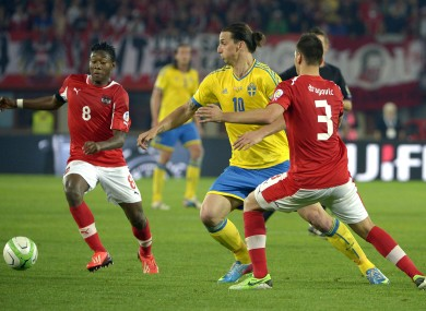 Sweden's Zlatan Ibrahimovic with David Alaba and Aleksandar Dragovic of Austria.