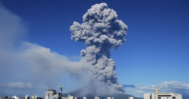 Photos: Clean-up begins after volcanic eruption in Japan coats city in ash