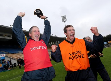 Antrim manager Kevin Ryan and senior Antrim captain Neil McManus celebrate at the final whistle last Saturday.