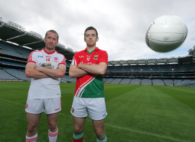 Tyrone's Stephen O'Neill and Kevin McLoughlin of Mayo.