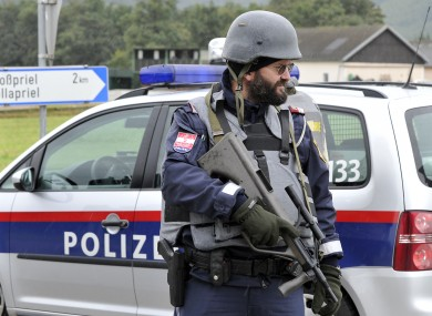 Police officer stands at the scene near Grosspriel in Austria.