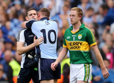 Highs and lows: Stephen Cluxton and Paul Flynn celebrate while Colm Cooper reflects on defeat.