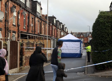 Police at the scene in Back Hill Top Avenue in the Harehills area of Leeds.