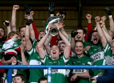 Portlaoise's Brian McCormack lifts the trophy.